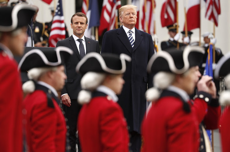 US President Donald Trump and French President Emmanuel Macron — the changing of the political guard. Picture: REUTERS