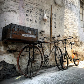 Less cars more bicycles by Renato Marques - Transportation Bicycles ( bicycle, old, past, obsolete, instagram, message, iphone, macau, transportation, china, daylight, iphoneography, future, statement, bicycles, alley )