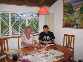 Photo: Dolores from Nyendo-lernen and Will Ruddick sorting the Gatina-Pesa for allotments during the launch