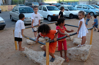 Photo: kids, playground in the middle of the Shem Hagdolim housing estate, they play on a gaz container