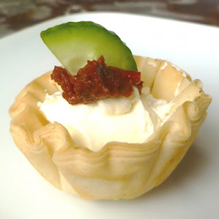 Mini Pastry Appetizers with Cream Cheese and Red Pepper Tapenade.