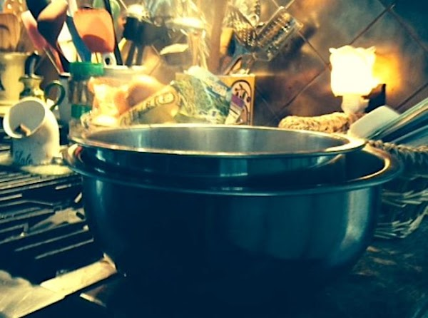 Transfer potatoes and cooking liquid to a large metal bowl. Fill a second larger...