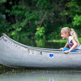 Loving the Canoe by Judy Soper - Babies & Children Children Candids ( water, child, girl, yard, canoe, rain )
