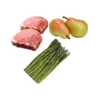 Pork Chops and Asparagus With Onion Pear Sauce.