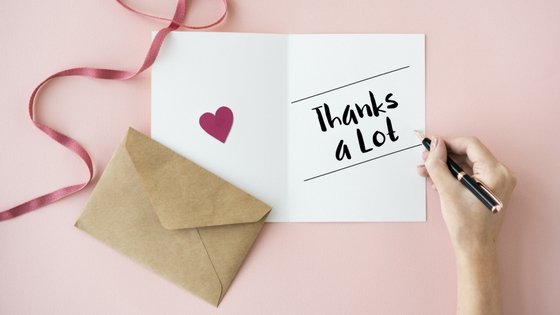A thank you card and envelope