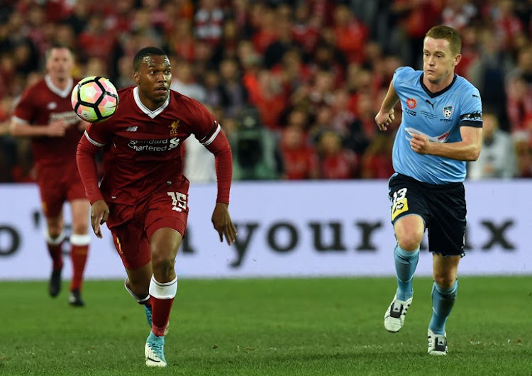Liverpool's Daniel Sturridge (L) controls the ball next to Sydney FC player Brandon O'Neill during their end-of-season friendly football match at the Olympic Stadium in Sydney on May 24, 2017.