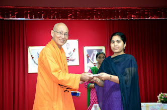 Photo: Mrs Pavani, volunteer,  receiving a token of appreciation from Swamiji