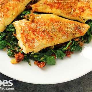 Sauteed Cod with Sun-Dried Tomatoes, Spinach and Kale.