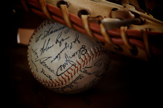 Photo: Day 48 - Hot Stove League  It's not shaping up to be a good winter for the New York Mets, so I offer this stroll down memory lane for Mets fans - a ball signed by the '69 Mets.  My dad won this ball back in 1969 in a random drawing. Signed by (nearly) all of the World Champion New York Mets, this angle shows the only two players on the team to go to the Hall of Fame - Tom Seaver and Nolan Ryan. The other Hall of Famers on the team were manager Gil Hodges and coach Yogi Berra. (Berra didn't sign the ball.)  #365Project
