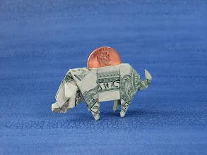 Photo: Model: Dollar Bill Piggy Bank;  Creator: John Montroll;  Folder: William Sattler;  1 dollar plus a penny;  Publication: Making More With Money (OrigamiUSA) http://www.origami-usa.org/