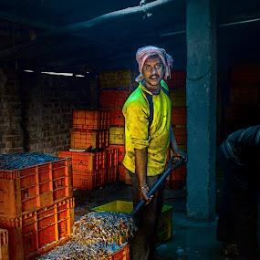 MAN AT WORK FISH GODOWN by Saheb Sarkar - People Portraits of Men