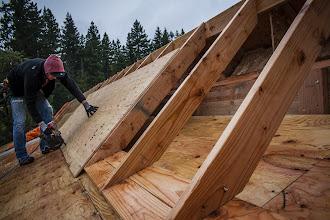 Photo: Sheathing the 12-12 overlay roof.