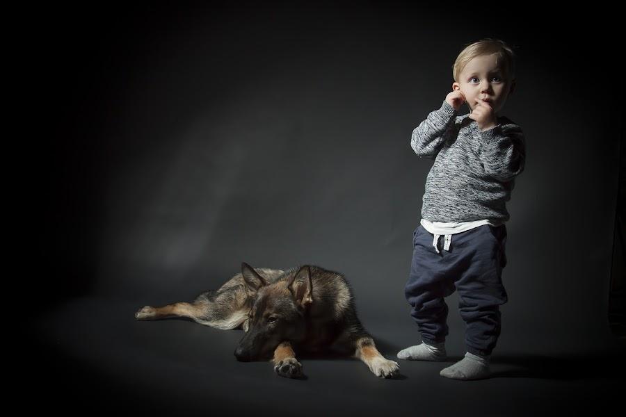 A boy and his dog. by Jerry Sjödin - Babies & Children Child Portraits ( young boy, black background, child, child photography, dark background, toddler, dog, boy, black,  )
