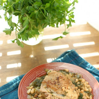 Braised Chicken Thighs with Spinach and White Beans.