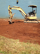 Photo: Digging by the cafeteria for the custodial room