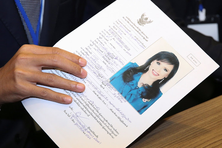 An official holds up Thai Princess Ubolratana Rajakanya Sirivadhana Barnavadi's application form in Bangkok, Thailand, February 8 2019. Picture: REUTERS/Athit Perawongmetha