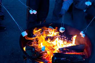 Photo: Roasting marshmellows over the fire.