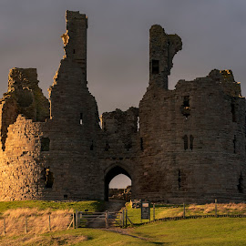Great Tower by Darrell Evans - Buildings & Architecture Public & Historical ( dunstanburgh castle, sky, gatehouse, defence, old, decay, building, stone, towers, outdoor, ashlar stone, northumberland, uk, grass, ruins, gate, fortification, no people, stronghold, tower )