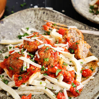 Spicy Italian Sausage Meatballs over Egg Noodles.