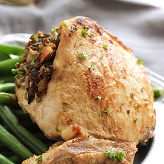 Stuffed Pork Chops with Wild Rice, Date and Apple Stuffing.