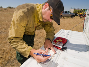 Photo: West Cinder Prescribed Burn, Twin Falls District BLM, Idaho, August 3, 2010, Fire Effects Monitor Dustin Smith taking field weather observations