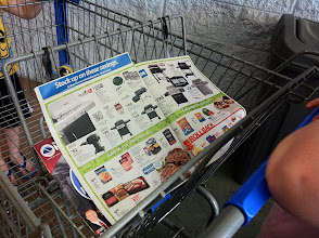 Photo: I grabbed the local ad on the way in. A few of the things I had in mind were in there. YAY! One thingI love about Walmart is even if an item isn't listed in the ad I can be sure it is a great price! There are roll backs all over the store!