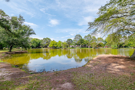 On-site pond with trees surrounding