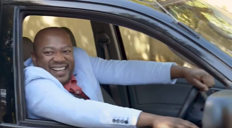 The jealous black neighbour in kulula.com's 'Don't be a travel hater' ad, shortly before he drives over a white couple's luggage.
