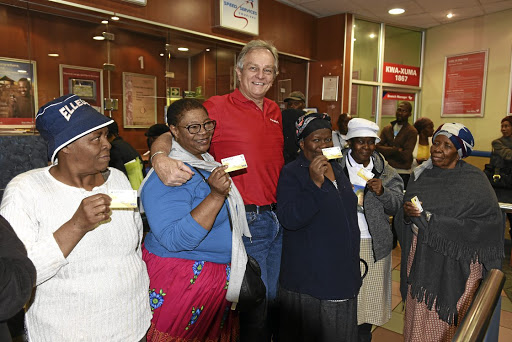 Hands on: CEO Mark Barnes was at the Kwaxuma Post Office at Jabulani Mall in Soweto earlier in September to meet social grant recipients after the switch from the previous service provider. Picture: FREDDY MAVUNDA
