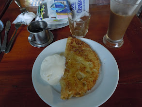 Photo: Banana pancake with yogurt and coffee at Nina's (we're in Hue now)