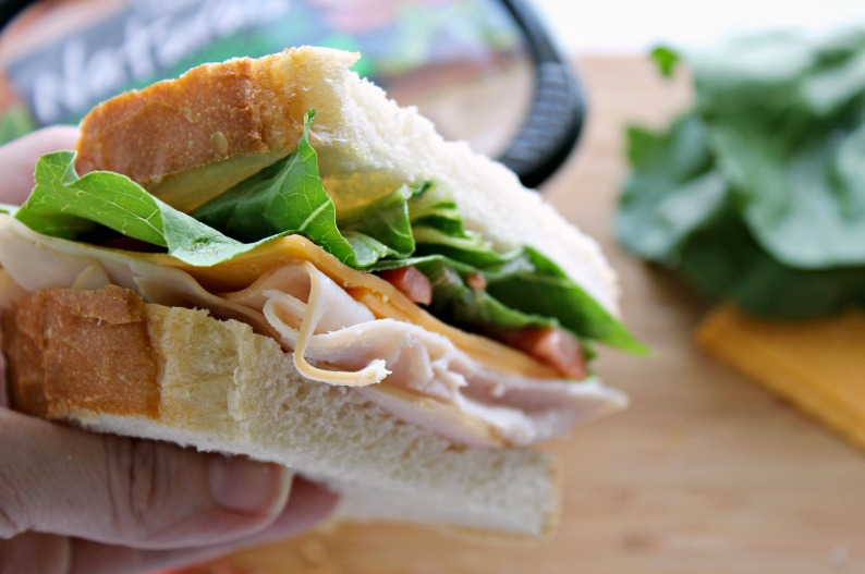 A classic turkey sandwich never goes out of style, especially when you add sourdough, romaine lettuce, and cheddar cheese to the all-natural turkey