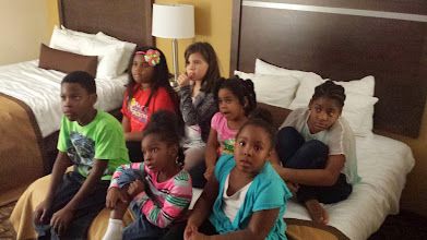 Photo: piled on the bed watching TV