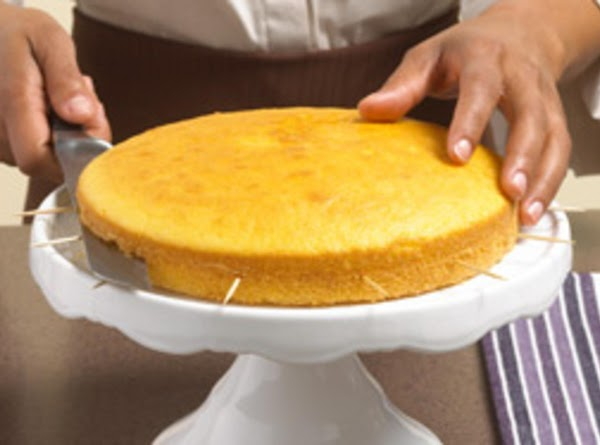 Stack cake layers on plate, spreading pudding mixture between layers with serrated knife.