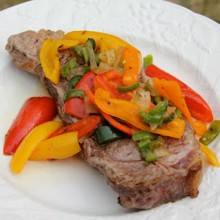 Oven Baked Steak with Peppers and Onions.