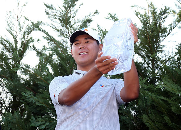 Kim Si-woo celebrates after winning The Players Championship golf tournament at TPC Sawgrass Stadium Course in Florida, the US. Picture: USA TODAY