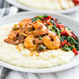 Cajun Shrimp and Cauliflower Grits with Greens.