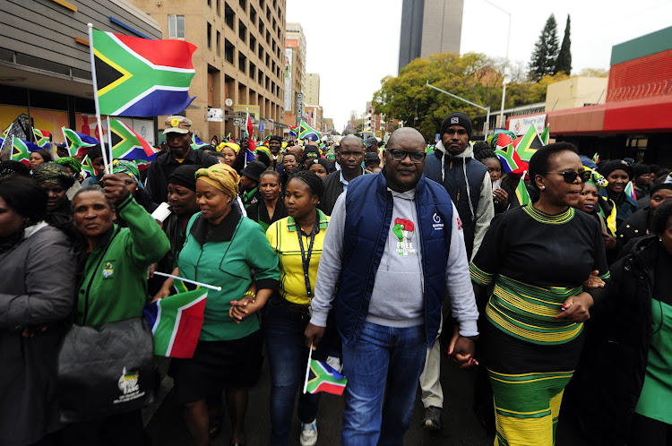 Gauteng Premier David Makhura leads a women's march to Union Buildings to commemorate a National Women's Day.