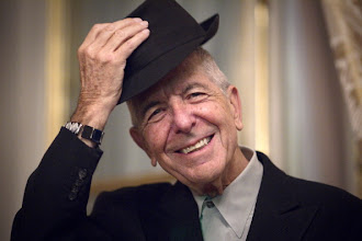 "Photo: Canadian singer and poet Leonard Cohen takes off his hat to salute on January 16, 2012 in Paris. Leonard Cohen's new album ""Old Ideas"" will be released in France on January 30. AFP PHOTO / JOEL SAGET (Photo credit should read JOEL SAGET/AFP/Getty Images)"
