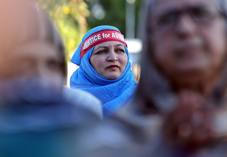 A woman wearing a headband attends a protest against the rape of an eight-year-old girl in Kathua, near Jammu, and a teenager in Unnao, Uttar Pradesh state, in Chennai, India April 14, 2018.