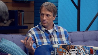 Tony Hawk Wears a Plaid Shirt and Silver Watch