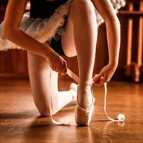 Tying my ballet shoes by Olga Gerik - Babies & Children Children Candids ( dancing, hands and feet, ballerina, ballet shoes, ballet, kids ballet )
