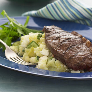Grilled Sirloin Steaks with Mashed Potatoes, Zucchini and Feta.