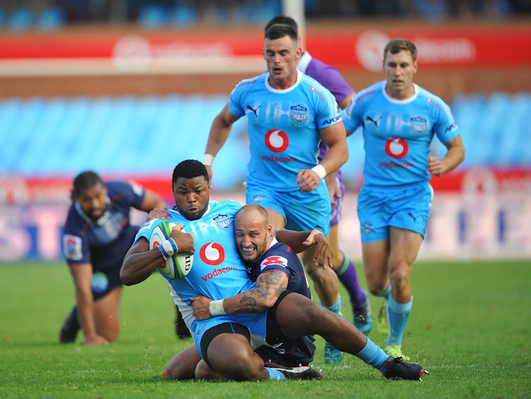 Lizo Gqoboka of the Vodacom Blue Bulls is tackled by Billy Meakes of Rebels during the Super Rugby match at Loftus Versfeld Stadium on Saturday April 21 2018.