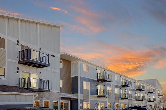 Village West's apartment building at dusk
