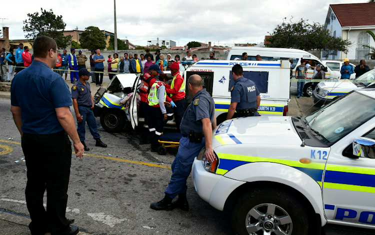 Four police officers were injured when their vehicles collided during a high speed chase after a hijacking suspect