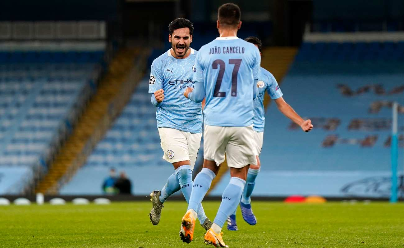 Alt: Ilkay Guendogan of Manchester City celebrates with teammate Joao Cancelo - Photo by Tim Keeton - Pool/Getty Images