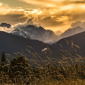 Summer's Last Sunset by Leon Kauffman - Landscapes Sunsets & Sunrises ( clouds, mountains, sunset, montana, mission mountains )