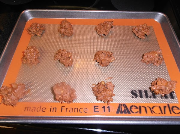 drop heaping rounded teaspoons of cookie dough onto greased baking sheets or silicon baking...