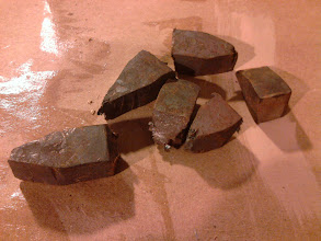 Photo: A stack of rough forged game pieces. These are pretty bad.