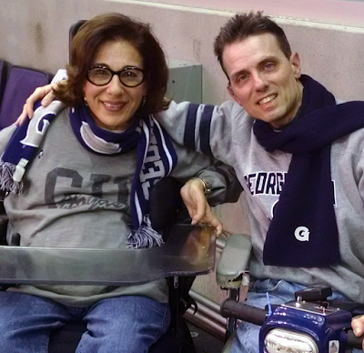 A photo of Tony and Sheri. They are wearing grey sporty sweatshirts and Tony's arm is around Sheri.